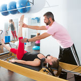 Pilates aerobic personal trainer man in cadillac Royalty Free Stock Image