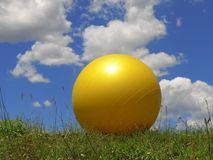 Pilates ball. On the lawn royalty free stock image