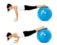 Pilates ball exercise. Fit healthy woman uses pilates gym ball as part of toning and muscle building training exercise. isolated on white, see portfolio for more Stock Images
