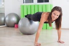 Pilates balls exercise. Girl doing pilates in studio stock image