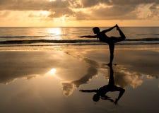Pilates in the beach Stock Photo
