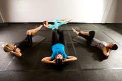 Pilates Class. Four women working on their abdominal muscles in a Pilates class Stock Photos