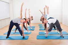 Pilates class exercising in a gym Royalty Free Stock Image