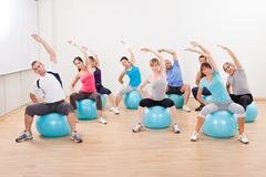 Pilates class exercising in a gym Stock Image