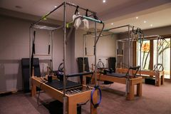 Pilates class gym equipment reformers beds. royalty free stock image