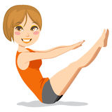 Pilates Exercise. Cute and slim brunette woman with short hair exercising pilates stretching workout Stock Photo