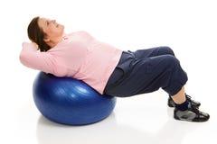 Pilates - Festziehen von Abdominals Stockfotos