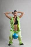 Pilates. Girl in light green workout clothes does pilates Royalty Free Stock Images