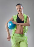 Pilates. Girl in light green workout clothes does pilates Royalty Free Stock Photo