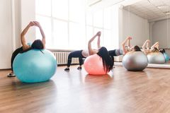 Fit women working out on balls in fitness studio royalty free stock photo