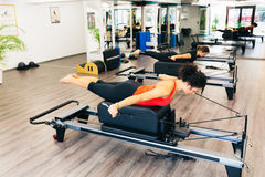 Pilates gym. Women working out in a pilates gym Royalty Free Stock Images