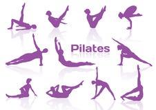 Pilates Haltungen in den violetten Schattenbildern Stockbilder