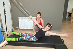 Pilates with instructor Stock Images