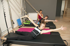 Pilates with instructor Stock Photos