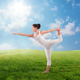 Pilates on the lawn. Flexible woman doing pilates on the lawn Royalty Free Stock Image