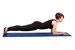 Pilates - Low Plank. Young female doing Low Plank Royalty Free Stock Images