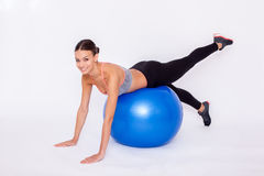 Pilates must be positive. Shot of attractive woman working out with fitness balls and smile to camera Royalty Free Stock Image