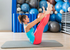 Pilates Open Leg Rocker exercise on mat woman Stock Photos