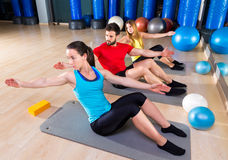 Pilates people group exercise man and women. Pilates people group exercise men and women at fitness gym stock images