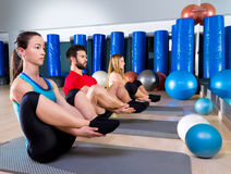 Pilates people group the seal exercise group. Pilates people group the seal exercise men and women at fitness gym Royalty Free Stock Photo