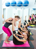 Pilates personal trainer helping women Stock Photo