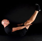 Pilates Position - the Hundred. On a black background Royalty Free Stock Images