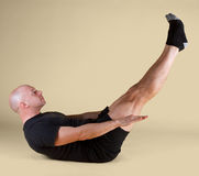 Pilates Position - the Hundred. On a light background Royalty Free Stock Photo