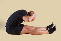 Pilates Position - Roll Up. On a light background Royalty Free Stock Images
