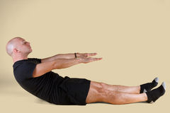 Pilates Position - Roll Up. On a light background Stock Photo