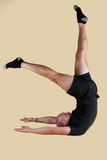 Pilates Position - Shoulder Stand Scissors. On a light background Stock Photo