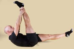 Pilates Position - Single Straight Leg. On a light background Royalty Free Stock Photos