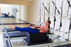 Pilates reformer woman back stroke exercise. Workout at gym indoor Royalty Free Stock Photos