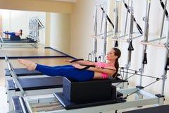 Pilates reformer woman back stroke exercise Royalty Free Stock Photos
