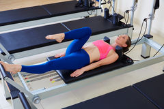 Pilates reformer woman foot work exercise stock images