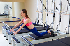 Pilates reformer woman front split exercise Royalty Free Stock Images