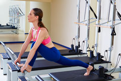 Pilates reformer woman front split exercise. Workout at gym indoor Royalty Free Stock Image