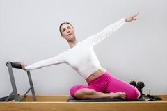 Pilates reformer woman gym fitness teacher legs Royalty Free Stock Images