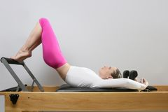 Pilates reformer woman gym fitness teacher legs Royalty Free Stock Photos