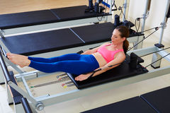 Pilates reformer woman hundred exercise. Workout at gym indoor Royalty Free Stock Image