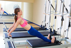 Pilates reformer woman long back stretch exercise. Workout at gym indoor Royalty Free Stock Image
