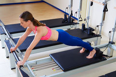 Pilates reformer woman long stretch exercise Stock Photography