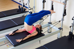Pilates reformer woman over head exercise. Workout at gym indoor Royalty Free Stock Image