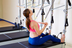 Pilates reformer woman roll up chest expansion Stock Photos