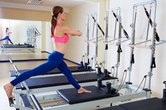 Pilates reformer woman russian split exercise. Workout at gym indoor Royalty Free Stock Photos