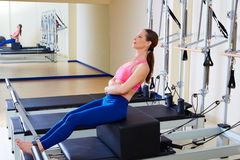 Pilates reformer woman short box flat exercise. Workout at gym indoor Royalty Free Stock Images