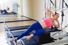 Pilates reformer woman short box side stretch Royalty Free Stock Photo