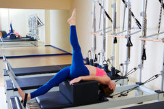 Pilates reformer woman short box tree exercise. Workout at gym indoor Stock Photo