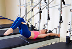 Pilates reformer woman short spine exercise. Workout at gym indoor Royalty Free Stock Photography