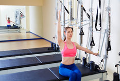 Pilates reformer woman side push through exercise. Workout at gym indoor Stock Photo