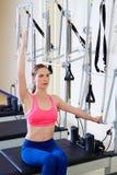 Pilates reformer woman side push through exercise Stock Image